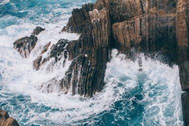 Beautiful landscape with cliffs and wavy sea in Riomaggiore, Italy stock vector