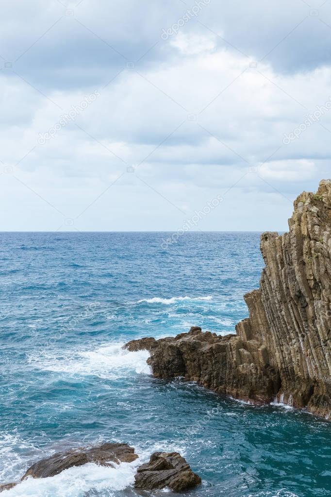 beautiful cliffs and picturesque seascape in Riomaggiore, Italy