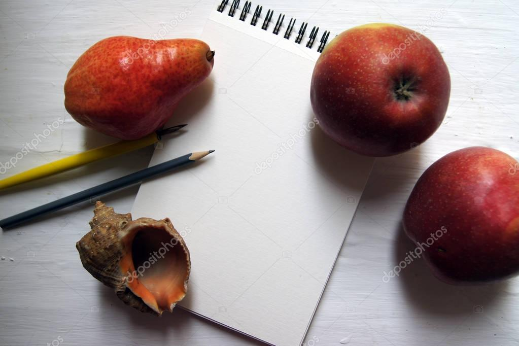 notebook, pencil, pen and fruits