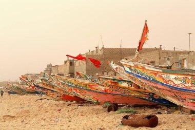 Fishing pirogues-red flags on the beach-port of Guet-Ndar. Saint-Louis-du-Senegal. 2994