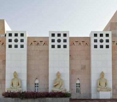Buddha statues with dhyana -sides- and abhaya -central- mudras-hand gestures. N.facade of Loulan Museum holding archaeological finds from the ancient Loulan Kingdom. Ruoqiang Charkhlik-Xinjiang-China.