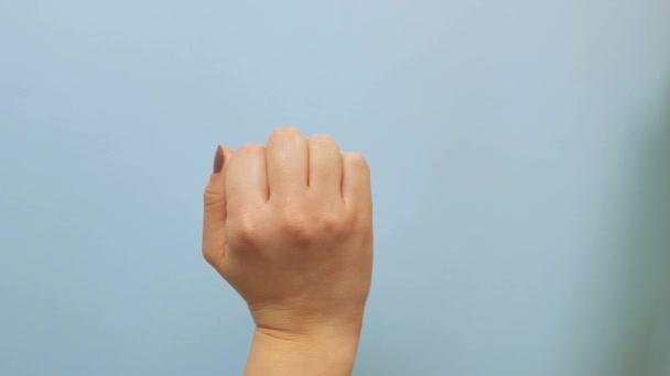 A női kéz gesztus jelentése a nyugati kultúrákban Baszd meg, vagy baszd meg az elszigetelt kék képernyőt.