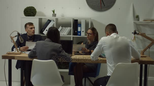 Business colleagues working at open space office