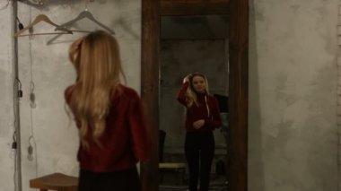 Portrait of lovely girl posing near mirror at home