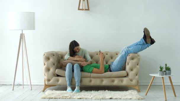 Lovely couple relaxing on the sofa at home