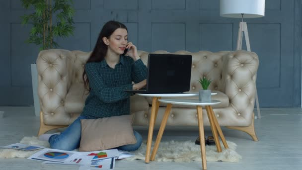 Successful freelance woman working in home office