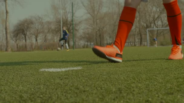 Soccer player placing the ball on penalty spot