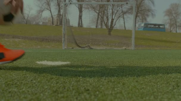 Soccer player executing penalty kick during training