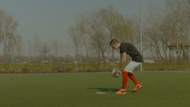 Handsome soccer player taking a penalty kick