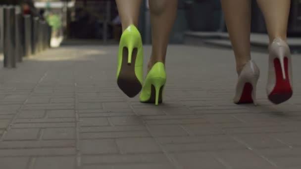Elegant women in high heels taking a walk on street