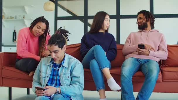 Group of diverse young friends relaxing at home
