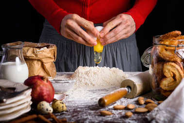 cropped shot of person cooking dough at table with ingredients