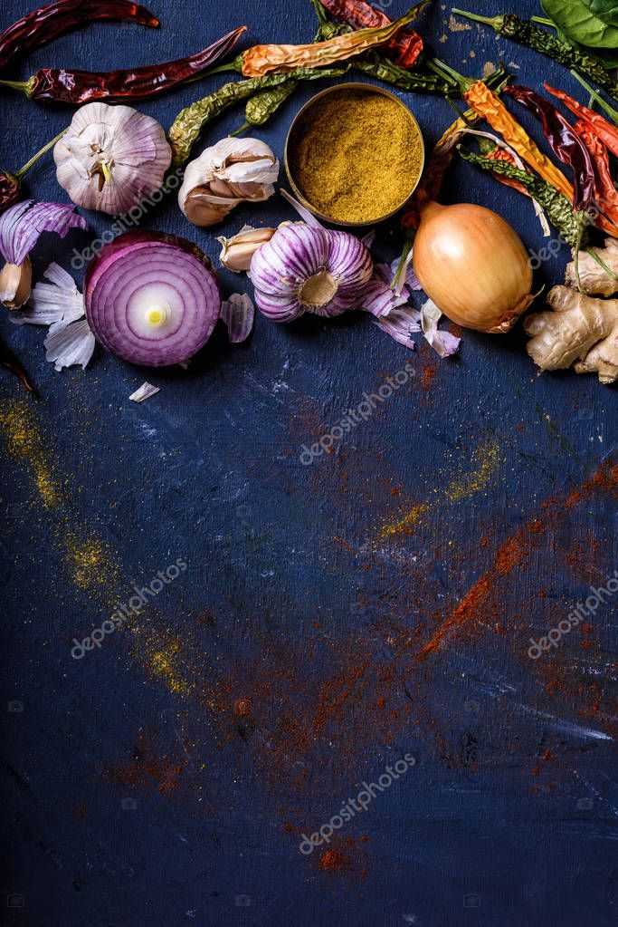 top view of various spices on blue background