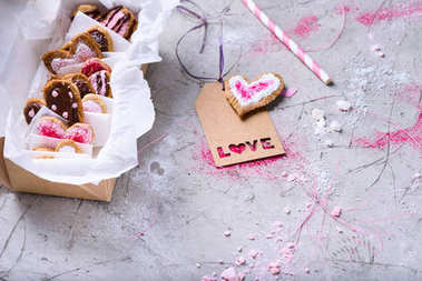 close-up view of box with sweet valentines cookies with love tag on grey surface