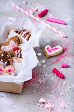 close-up view of collection of heart shaped valentine cookies on grey surface
