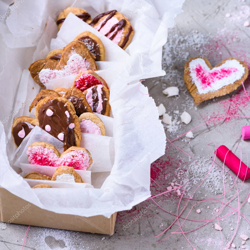 close-up view of collection of sweet heart shaped cookies on grey surface