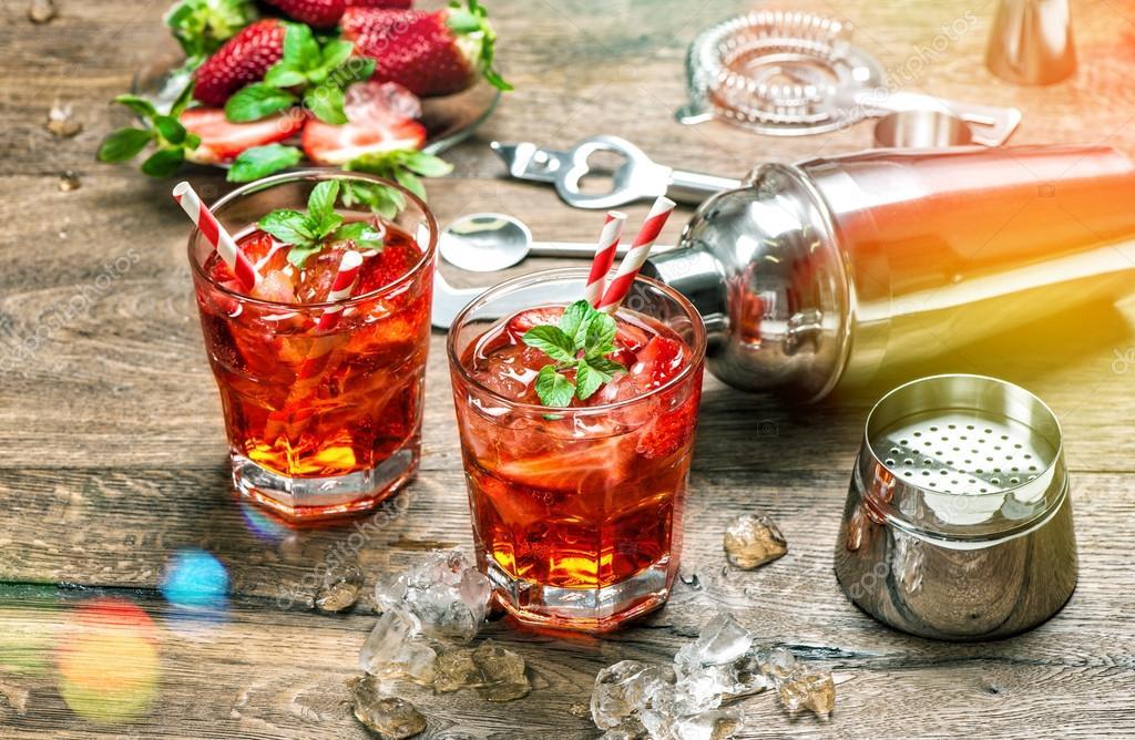 Red drink with ice. Aperitif, mojito, caipirinha, juice, cocktai
