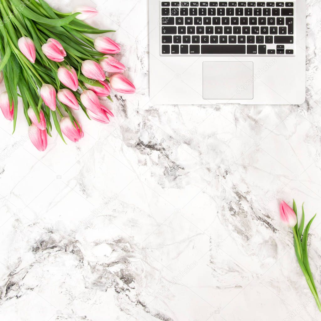 Office desk flat lay flowers Laptop tulips