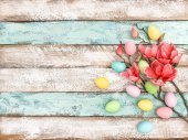 Easter eggs flowers decoration wooden background