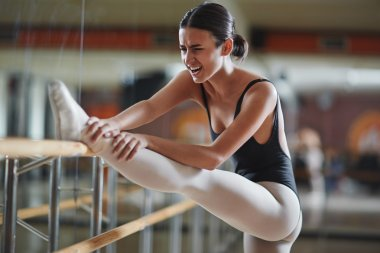 Ballerina making effort during repetition