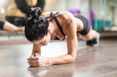 Female athlete doing plank exercise