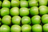 Background of granny smith apples in rows