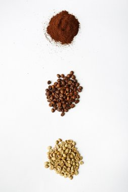 Black, white and grind coffee beans