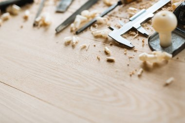 Row of carpentry tools and sawdust