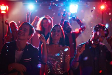 Young people having fun at disco party