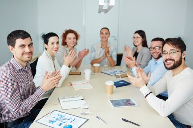Business people clapping hands after presentation