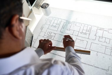 Architect making sketch for engineering project