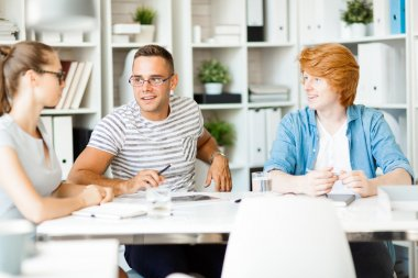 Employees having discussion at the office