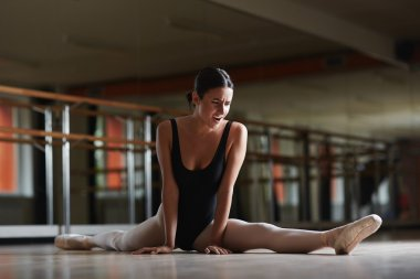 Ballerina making effort during stretching