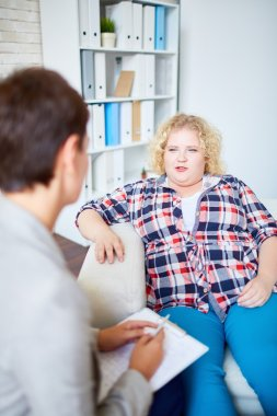 woman talking to counselor during her visit