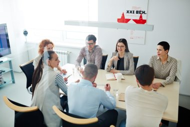 Successful managers consulting at meeting