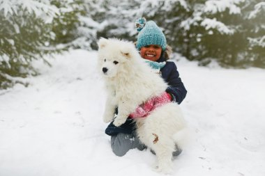 Happy girl with her pet during play