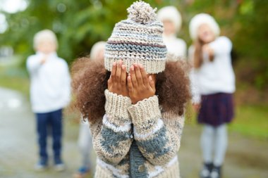 Crying girl hiding her face