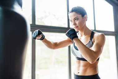 Female fighter practicing kickboxing exercise