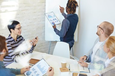 Business coach drawing schemes on whiteboard