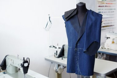 Unfinished jacket and trousers in tailor workshop