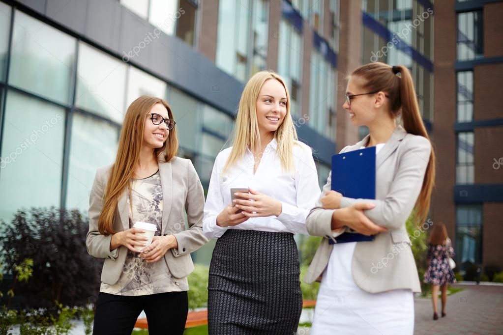 Pretty women talking in urban environment