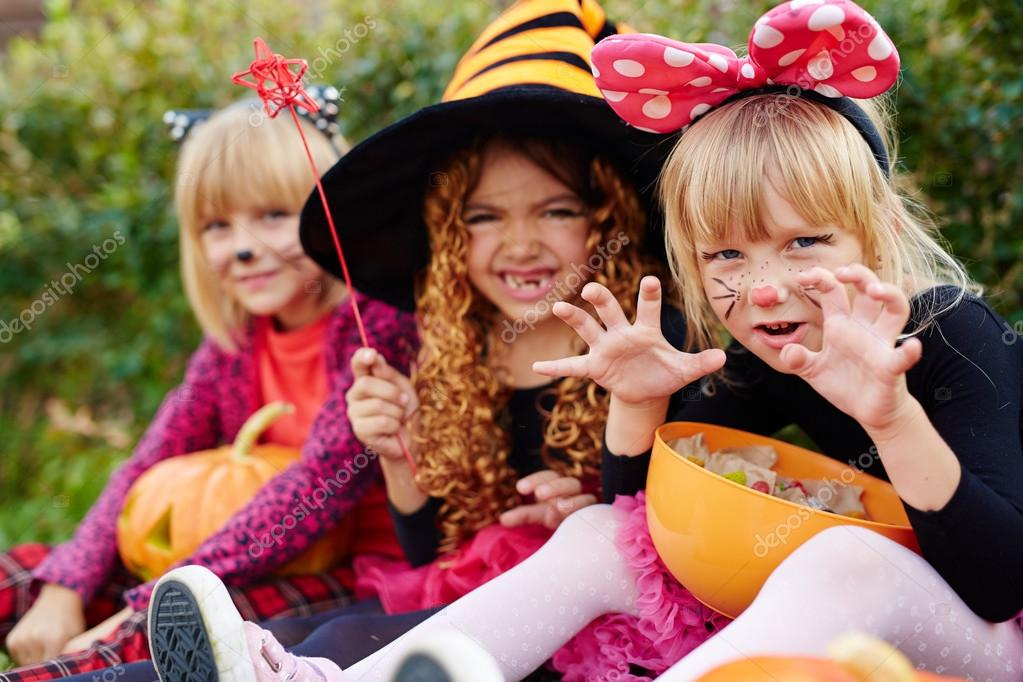 three girls in halloween costumes stock photo 125885794 - Halloween Costumes Three Girls