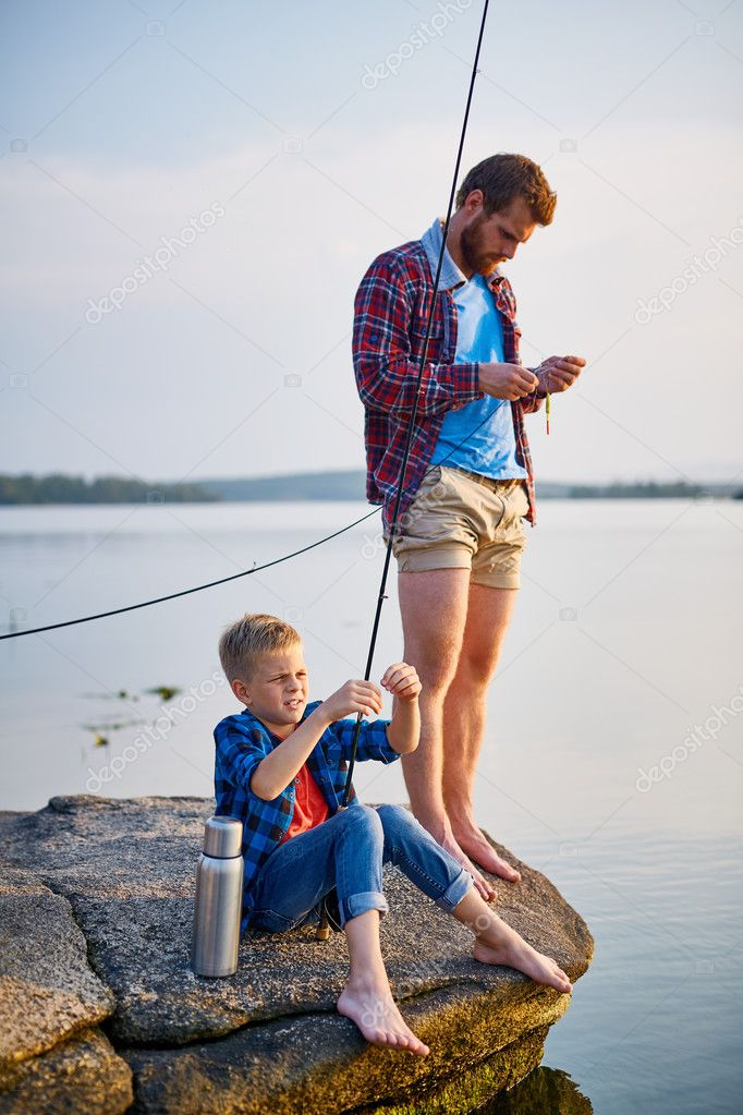 Father and son spending weekend by fishing