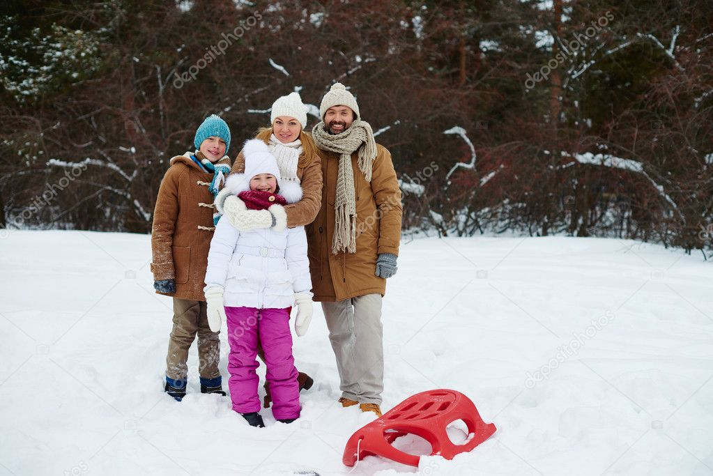 Family standing in snowdrift in natural environment