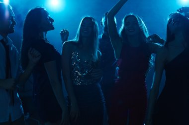 Group of dancers in night club