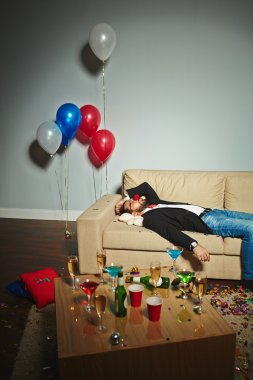 Drunk man sleeping after party