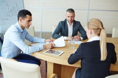 Coach explaining principles of success in business