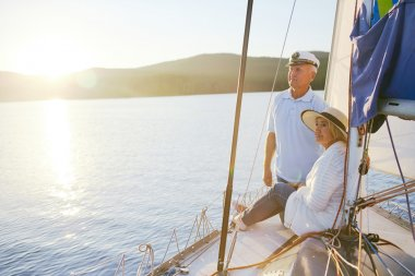 Senior couple traveling together on yacht
