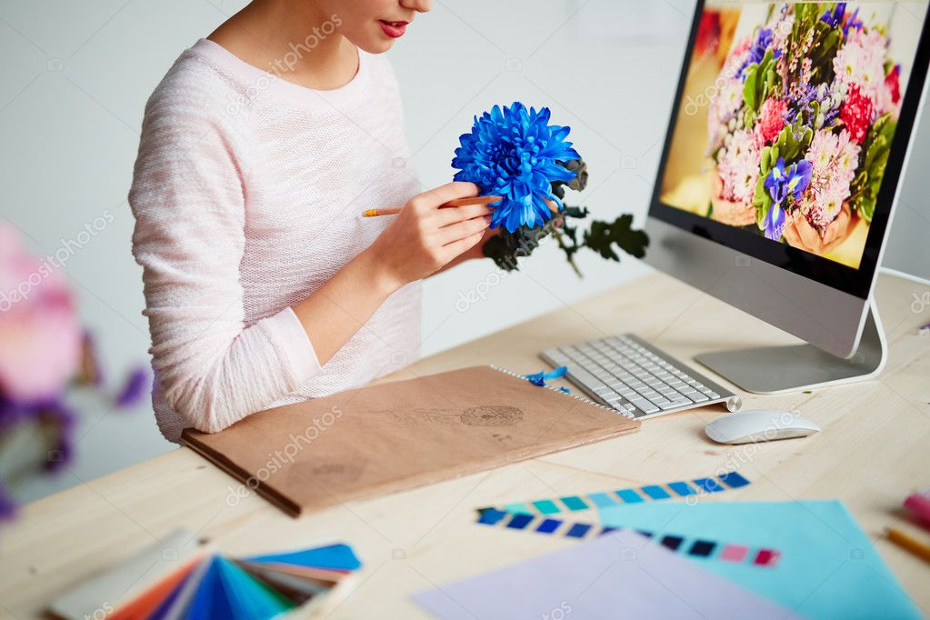 Woman drawing flower for graphic design