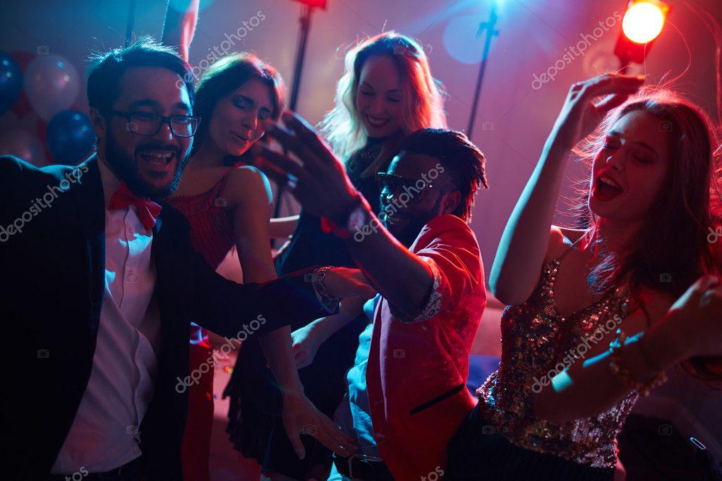 Ecstatic young people enjoying dance